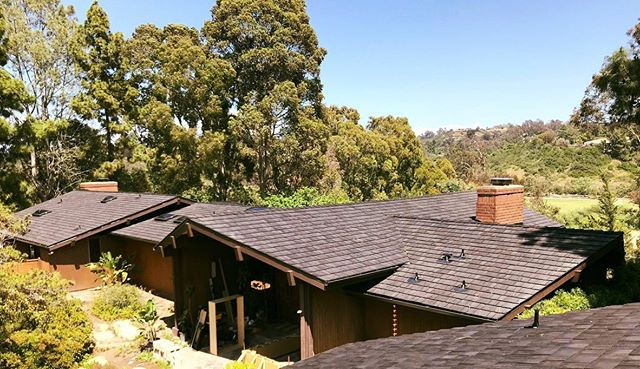 view from top on wood shingle roof on several buildings