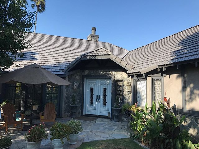 residential home with concrete tile roof view from lawn