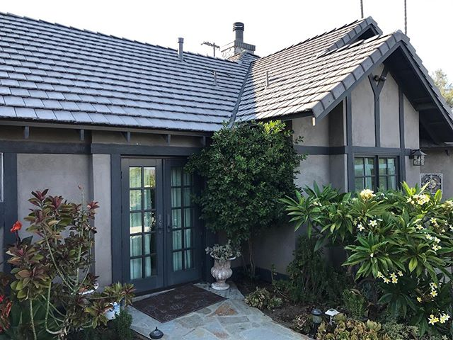 home with concrete tile roof view from backyard