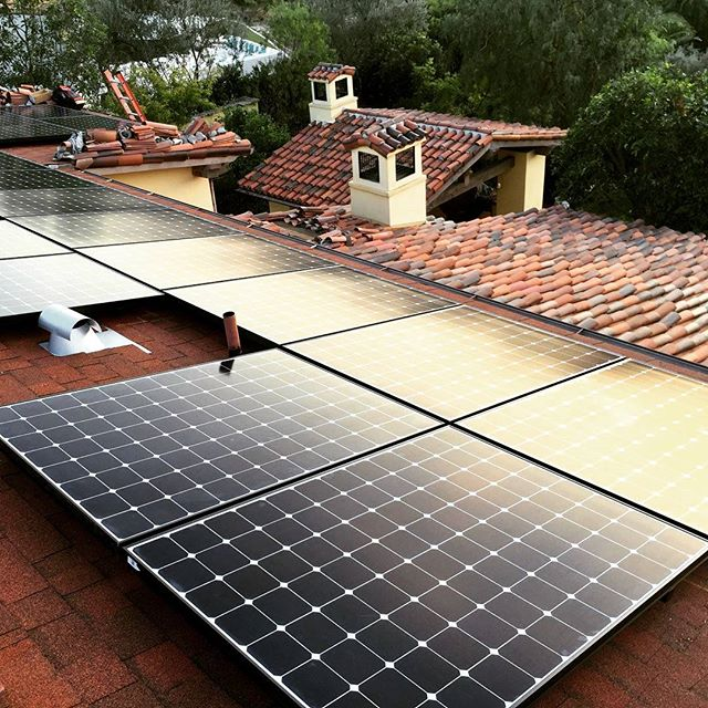 spanish tile roof replacement with integrated solar panels