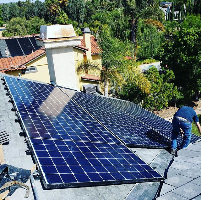 large solar panel installation on rooftop
