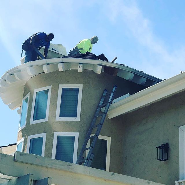 roofers replacing tile roof