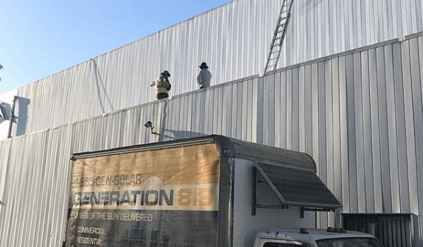 Gen819 truck and workers on commercial building