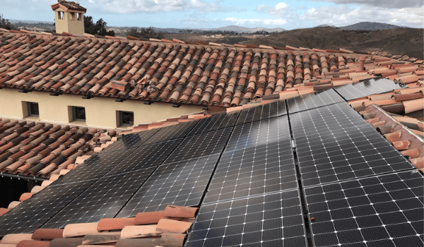 spanish tile roof with solar panels integrated