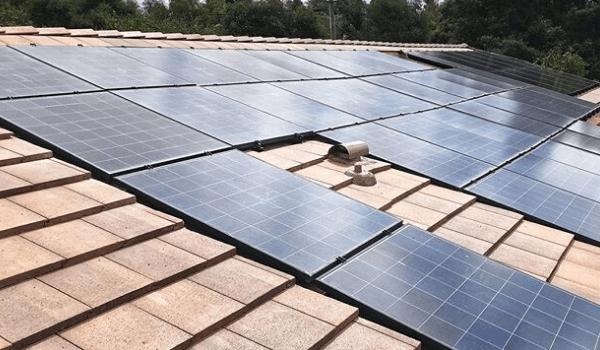 Residential solar panels on concrete tile roof