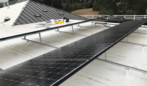 black solar panels on flat roof